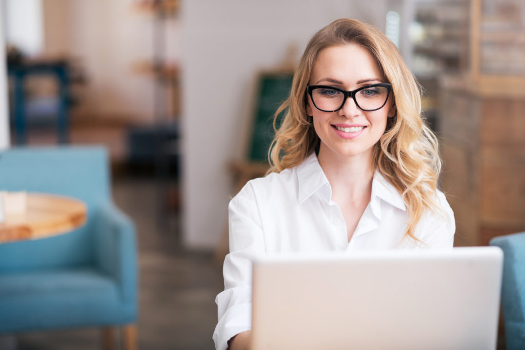 Attractive young woman using laptop